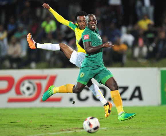 Percy Tau of Mamelodi Sundowns challenged by Siyabonga Dube of Golden Arrows during the Absa Premiership 2016/17 match between Golden Arrows and Mamelodi Sundowns at the Prince Magogo Stadium, South Africa on 28 April 2017 ©Samuel Shivambu/BackpagePix
