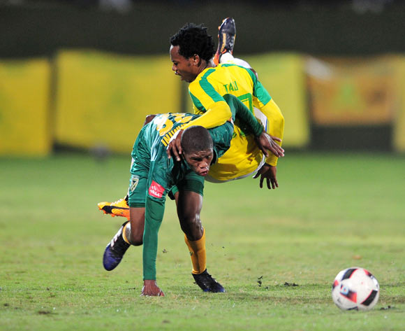Romario Dlamini of Golden Arrows challenged by  Percy Tau of Mamelodi Sundowns during the Absa Premiership 2016/17 match between Golden Arrows and Mamelodi Sundowns at the Prince Magogo Stadium, South Africa on 28 April 2017 ©Samuel Shivambu/BackpagePix