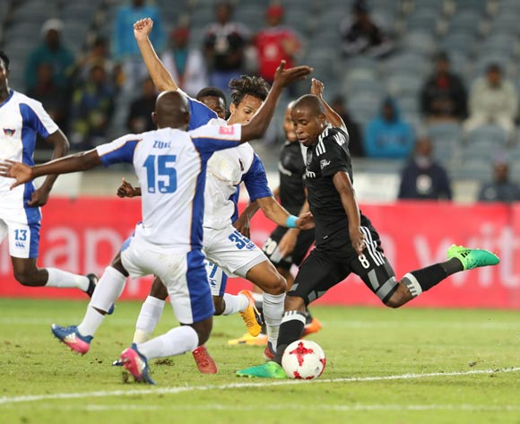 Thabo Matlaba of Orlando Pirates shoots closed down by Sandile Zuke (l) and Kristopher Bergman of Chippa United during the 2016/17 Absa Premiership football match between Orlando Pirates and Chippa United at Orlando Stadium, Johannesburg on 29 April 2017 ©Gavin Barker/BackpagePix