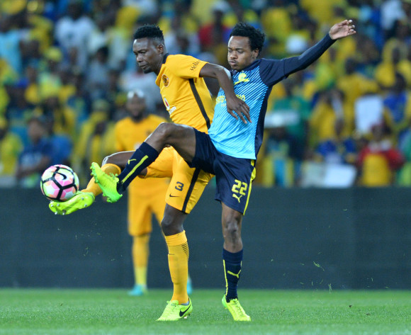 Percy Tau of Mamelodi Sundowns challenged by Eric Mathoho of Kaizer Chiefs during the Absa Premiership 2016/17 match between Kaizer Chiefs and Mamelodi Sundowns at the FNB Stadium, South Africa on 01 April 2017 ©Samuel Shivambu/BackpagePix