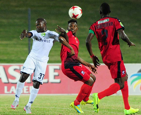 Christantus Uzoenyi of Bidvest Wits challenges Thato Lingwathi of Jomo Cosmos during the Absa Premiership 2016/17 match between Jomo Cosmos and Bidvest Wits at Tsakane Stadium on 4 April 2017 ©Aubrey Kgakatsi/BackpagePix