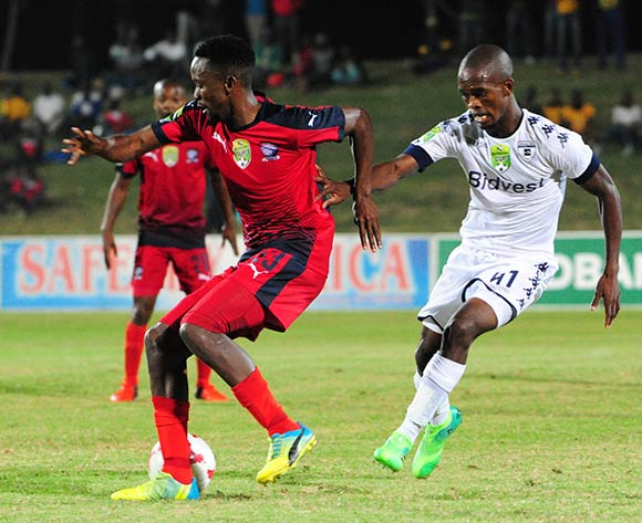 Linda Mntambo of Jomo Cosmos challenged by Phumlani Ntshangase of Bidvest Wits during the Absa Premiership 2016/17 match between Jomo Cosmos and Bidvest Wits at Tsakane Stadium on 4 April 2017 ©Aubrey Kgakatsi/BackpagePix