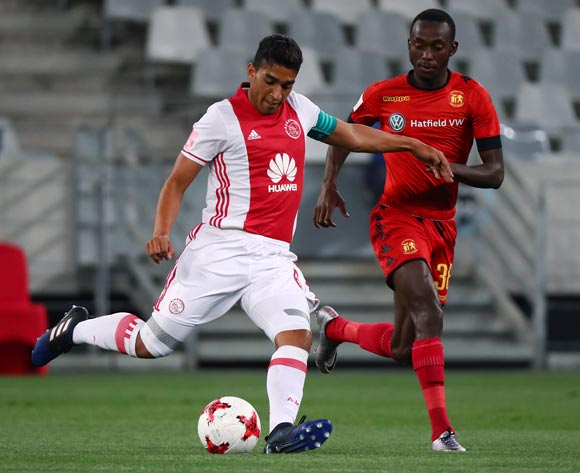 Travis Graham of Ajax Cape Town evades challenge from Peter Shalulile of Highlands Park during the Absa Premiership 2016/17 football match between Ajax Cape Town and Highlands Park at Cape Town Stadium, Cape Town on 12 April 2017 ©Chris Ricco/BackpagePix