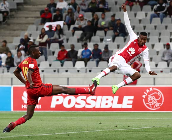 Thabo Mosadi of Ajax Cape Town fires a shot off evades challenge from Siyabonga Nhlapho of Highlands Park during the Absa Premiership 2016/17 football match between Ajax Cape Town and Highlands Park at Cape Town Stadium, Cape Town on 12 April 2017 ©Chris Ricco/BackpagePix
