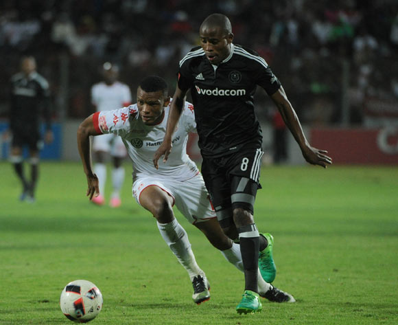 Thabo Matlaba of Orlando Pirates is challenged by Mothobi Mvala of Highlands Park during the Absa Premiership match between Highlands Park and Orlando Pirates  on 15 April 2017 at Makhulong Stadium ©Sydney Mahlangu /BackpagePix