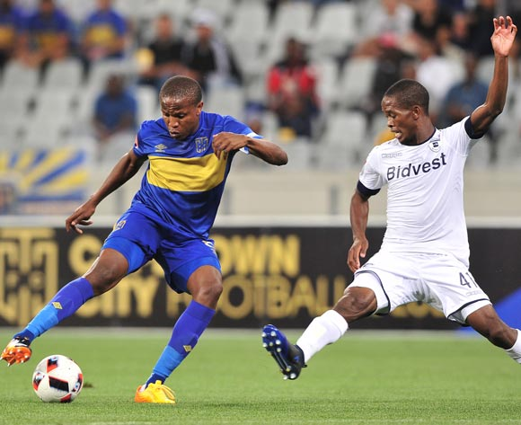 Lebogang Manyama of Cape Town City FC evades challenge from Phumlani Ntshangase of Bidvest Wits during the Absa Premiership 2016/17 football match between Cape Town City FC and Bidvest Wits at Cape Town Stadium, Cape Town on 19 April 2017 ©Chris Ricco/BackpagePix