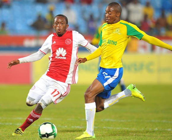 Thapelo Morena of Mamelodi Sundowns clears ball from Ayanda Makua of Ajax Cape Town during the Absa Premiership 2016/17 match between Mamelodi Sundowns and Ajax Cape Town at Loftus Versfeld Stadium in Pretoria, South Africa on 25 April 2017 ©Muzi Ntombela/BackpagePix