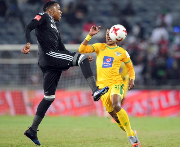 Nkosinathi Ogle of Baroka challenges Happy Jele of Orlando Pirates during the Absa Premiership match between Orlando Pirates and Baroka FC  on 26 April 2017 at Orlando Stadium ©Sydney Mahlangu /BackpagePix