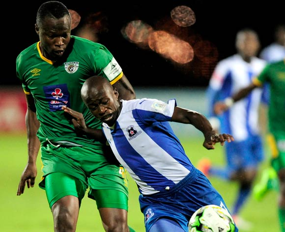Siphesihle Ndlovu of Maritzburg United pushes away the attacking Letladi Madubanya of Baroka FC during the Absa Premiership 2016/17 game between Maritzburg United and Baroka FC at Harry Gwala Stadium in Pietermaritzburg, KwaZulu-Natal on 14 April 2017 © Gerhard Duraan/BackpagePix