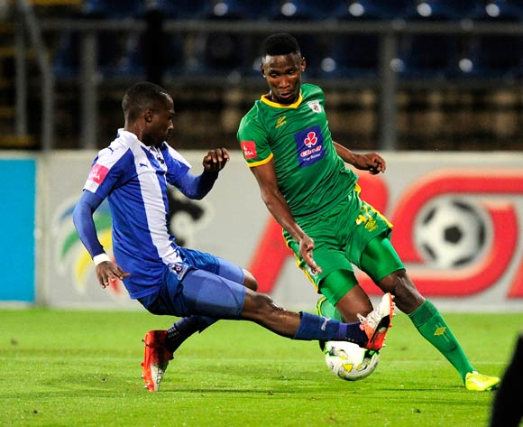 Loyiso Simandla of Baroka FC slides in to defend the attack on goal from Mpho Kgaswane of Baroka FC during the Absa Premiership 2016/17 game between Maritzburg United and Baroka FC at Harry Gwala Stadium in Pietermaritzburg, KwaZulu-Natal on 14 April 2017 © Gerhard Duraan/BackpagePix