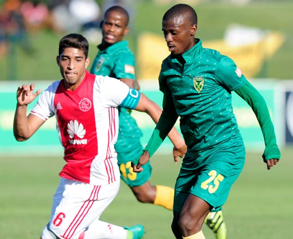 Nduduzo Sibiya of Lamontville Golden Arrows has the ball but the defence of Travis Graham (Captain) of Ajax Cape Town F.C. is closing fast during the Absa Premiership 2016/17 game between Golden Arrows and Ajax Cape Town at Prince Magogo Stadium in Durban, KwaZulu-Natal on 15 April 2017 © Gerhard Duraan/BackpagePix