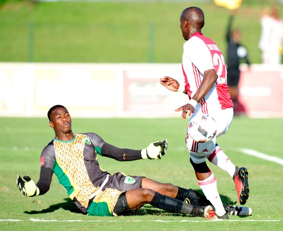 Nkosingiphile Gumede (GK) of Lamontville Golden Arrows  slides in to get the ball away from the attacking Mark Mayambela of Ajax Cape Town F.C. during the Absa Premiership 2016/17 game between Golden Arrows and Ajax Cape Town at Prince Magogo Stadium in Durban, KwaZulu-Natal on 15 April 2017 © Gerhard Duraan/BackpagePix