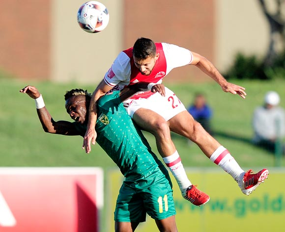 Roscoe Pietersen of Ajax Cape Town F.C. got higher to get the ball than Kudakwashe Mahachi of Lamontville Golden Arrows during the Absa Premiership 2016/17 game between Golden Arrows and Ajax Cape Town at Prince Magogo Stadium in Durban, KwaZulu-Natal on 15 April 2017 © Gerhard Duraan/BackpagePix