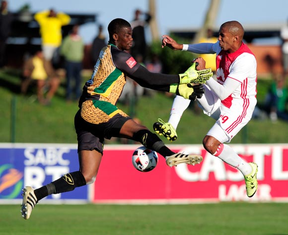 Nkosingiphile Gumede (GK) of Lamontville Golden Arrows  shows total commitment when defending the attack from Nathan Paulse of Ajax Cape Town F.C. during the Absa Premiership 2016/17 game between Golden Arrows and Ajax Cape Town at Prince Magogo Stadium in Durban, KwaZulu-Natal on 15 April 2017 © Gerhard Duraan/BackpagePix