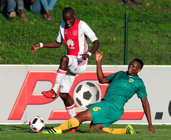 Kagisho Dikgacoi of Lamontville Golden Arrows  slides in to defend the attack from Mark Mayambela of Ajax Cape Town F.C. during the Absa Premiership 2016/17 game between Golden Arrows and Ajax Cape Town at Prince Magogo Stadium in Durban, KwaZulu-Natal on 15 April 2017 © Gerhard Duraan/BackpagePix