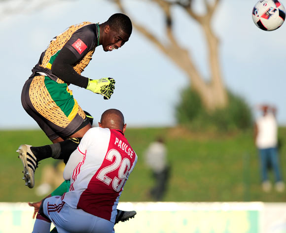 Nkosingiphile Gumede (GK) of Lamontville Golden Arrows  put body on the line when he went up high to defend his goal from Nathan Paulse of Ajax Cape Town F.C. during the Absa Premiership 2016/17 game between Golden Arrows and Ajax Cape Town at Prince Magogo Stadium in Durban, KwaZulu-Natal on 15 April 2017 © Gerhard Duraan/BackpagePix