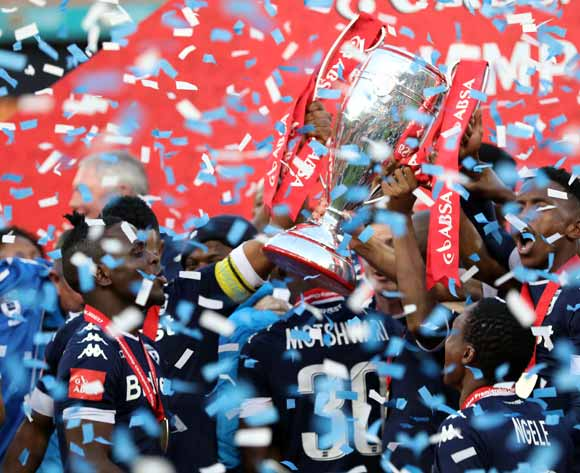 Thulani Hlatshwayo, Gabadinhno Mhango and Buhle Mkhwanazi of Bidvest Wits holds aloft the trophy as Wits are crowned the 2016/2017 Absa Premiership Champions during the Absa Premiership 2016/17 match between Kaizer Chiefs and Bidvest Wits at the FNB Stadium, Johannesburg South Africa on 27 May 2017 ©Muzi Ntombela/BackpagePix
