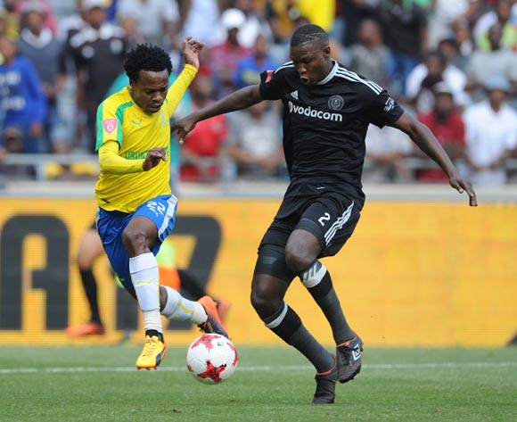 Percy Tau of Mamelodi Sundowns is challenged by Ayanda Gcaba of Orlando Pirates during the Absa Premiership match between Orlando Pirates and Mamelodi Sundowns  on 07 May 2017 at Orlando Stadium  © Sydney Mahlangu /BackpagePix