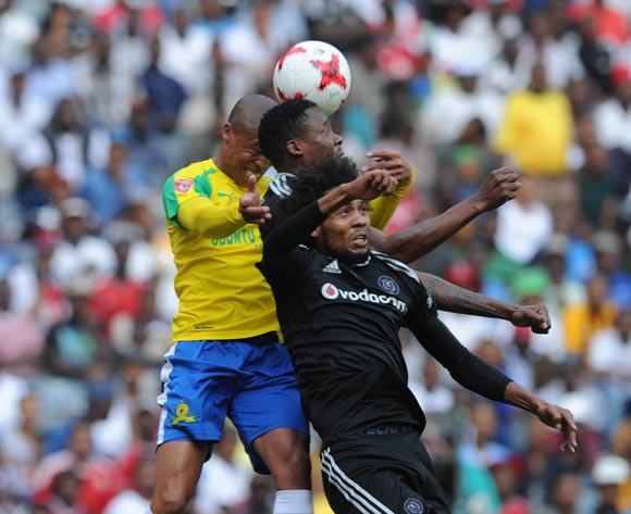 Thabo Nthethe of Mamelodi Sundowns is challenged by Issa Sarr of Orlando Pirates during the Absa Premiership match between Orlando Pirates and Mamelodi Sundowns  on 07 May 2017 at Orlando Stadium  © Sydney Mahlangu /BackpagePix