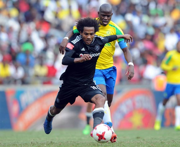 Hlompho Kekana of Mamelodi Sundowns is challenged by Issa Sarr of Orlando Pirates during the Absa Premiership match between Orlando Pirates and Mamelodi Sundowns  on 07 May 2017 at Orlando Stadium  © Sydney Mahlangu /BackpagePix