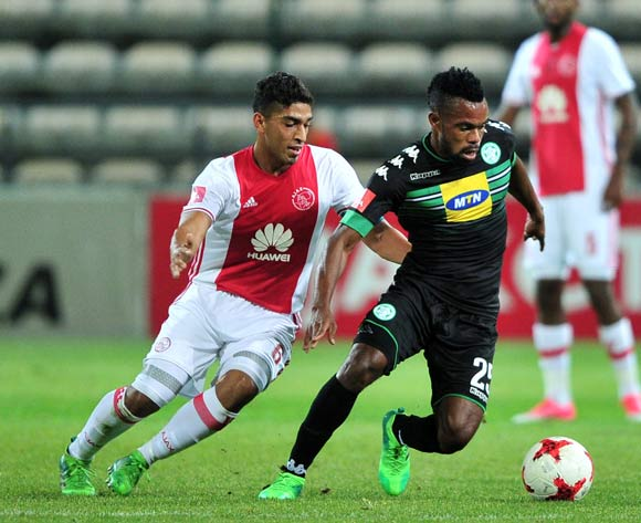 Didier Lebri of Bloemfontein Celtic in possession ahead of Travis Graham of Ajax Cape Town during the Absa Premiership 2016/17 game between Ajax Cape Town and Bloemfontein Celtic at Athlone Stadium in Cape Town on 13 May 2017 © Ryan Wilkisky/BackpagePix