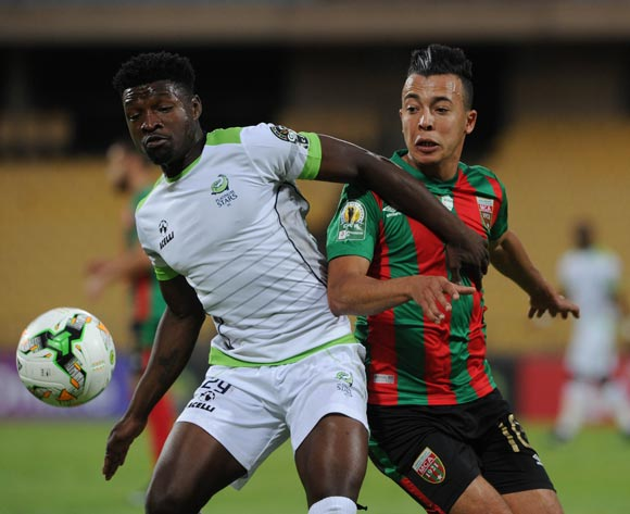 Michael Mabule of Platinum Stars is challenged by Sid Ahmed Aouadj of Moulouda Club Alger during the CAF Confederation Cup