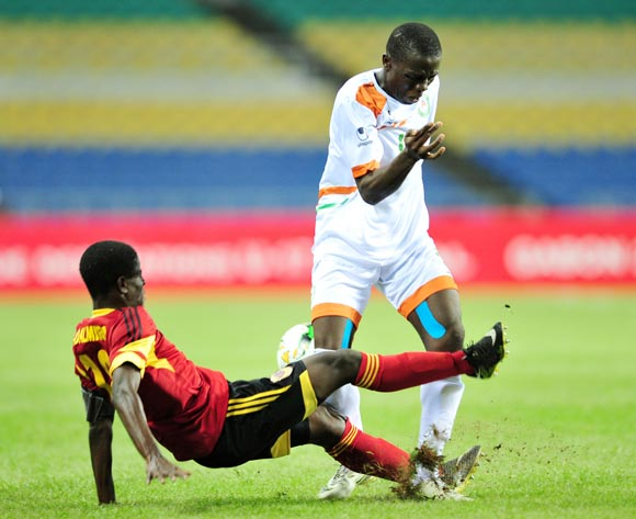 Ibrahim Namata of Niger tackled by Adalmiro Patricio Pacheco Da Silva of Angola during the 2017 Under 17 Africa Cup of Nations Finals football match between Angola and Niger at the Libreville Stadium in Gabon on 15 May 2017 ©Samuel Shivambu/BackpagePix