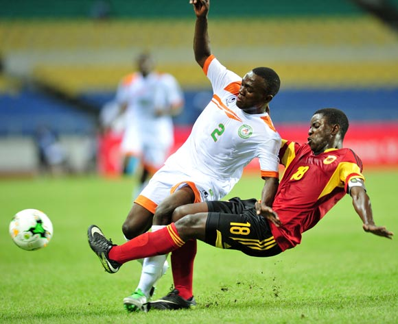 Yacine Wa Massamba of Niger tackled by Adalmiro Patricio Pacheco Da Silva of Angola during the 2017 Under 17 Africa Cup of Nations Finals football match between Angola and Niger at the Libreville Stadium in Gabon on 15 May 2017 ©Samuel Shivambu/BackpagePix