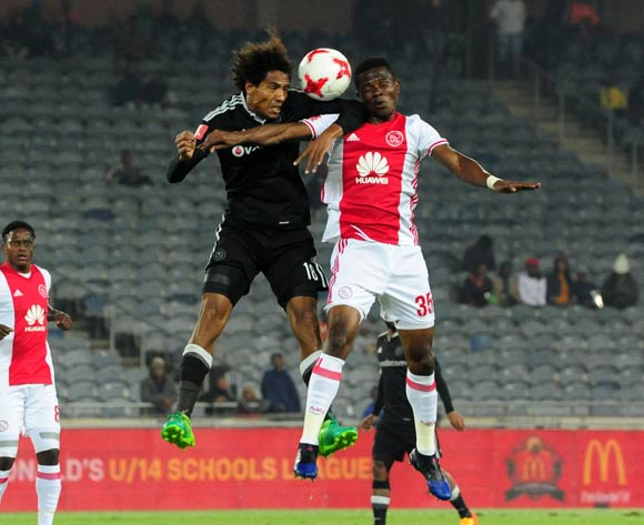 Issa Sarr of Orlando Pirates challenged by Rodrick Kabwe of Ajax Cape Town during the Absa Premiership 2016/17 football match between Orlando Pirates and Ajax Cape Town at Orlando Stadium, Cape Town on 17 May 2017 ©Aubrey Kgakatsi/BackpagePix