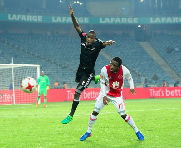 Thabo Matlaba of Orlando Pirates challenges Ayanda Makua of Ajax Cape Town during the Absa Premiership 2016/17 football match between Orlando Pirates and Ajax Cape Town at Orlando Stadium, Cape Town on 17 May 2017 ©Aubrey Kgakatsi/BackpagePix