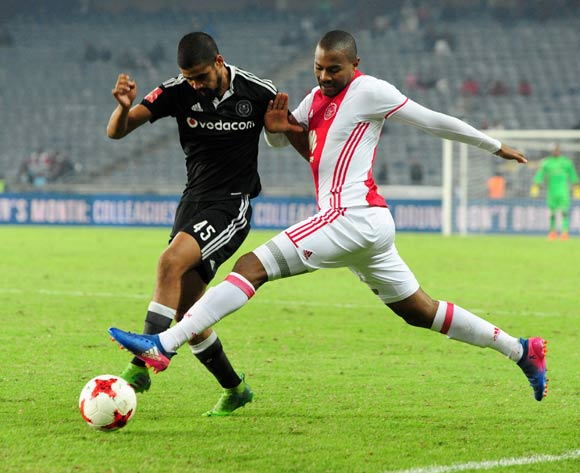 Prince Nxumalo of Ajax Cape Town challenges Abbubaker Mobara of Orlando Pirates during the Absa Premiership 2016/17 football match between Orlando Pirates and Ajax Cape Town at Orlando Stadium, Cape Town on 17 May 2017 ©Aubrey Kgakatsi/BackpagePix