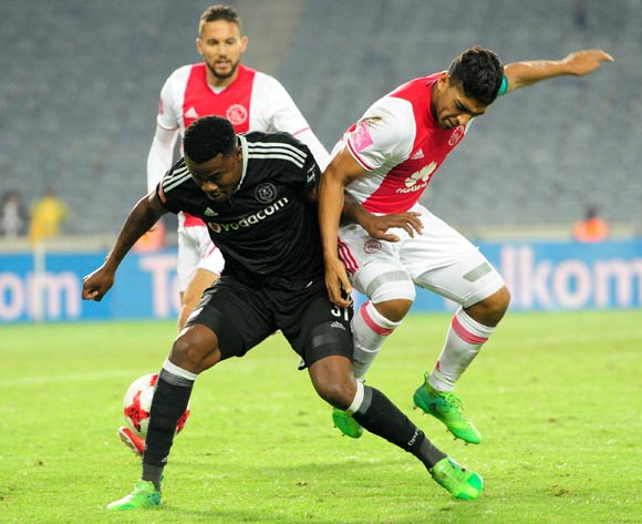 Thamsanqa Gabuza of Orlando Pirates challenged by Travis Graham of Ajax Cape Town during the Absa Premiership 2016/17 football match between Orlando Pirates and Ajax Cape Town at Orlando Stadium, Cape Town on 17 May 2017 ©Aubrey Kgakatsi/BackpagePix