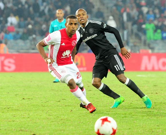 Luvuyo Memela of Orlando Pirates challenges Erwin Isaacs of Ajax Cape Town during the Absa Premiership 2016/17 football match between Orlando Pirates and Ajax Cape Town at Orlando Stadium, Cape Town on 17 May 2017 ©Aubrey Kgakatsi/BackpagePix