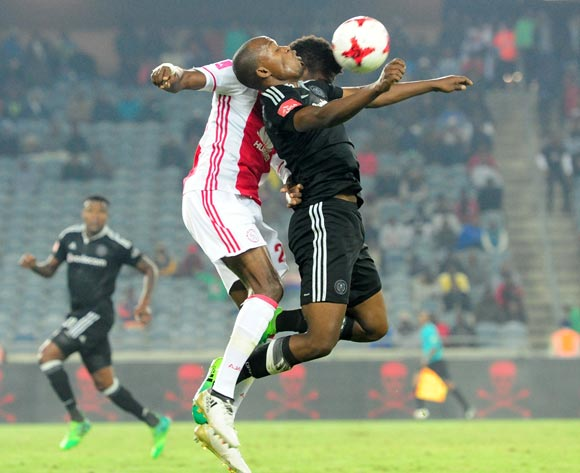 Gift Motupa of Orlando Pirates challenged by Lawrence Lartey of Ajax Cape Town during the Absa Premiership 2016/17 football match between Orlando Pirates and Ajax Cape Town at Orlando Stadium, Cape Town on 17 May 2017 ©Aubrey Kgakatsi/BackpagePix