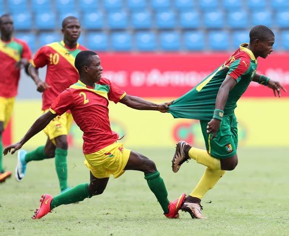 Rosin Christian Bella of Cameroon fouled by Samuel Conte of Guinea during the 2017 Under 17 Africa Cup of Nations Finals football match between Guinea and Cameroon at the Port Gentil Stadium, Gabon on 17 May 2017 ©Muzi Ntombela/BackpagePix