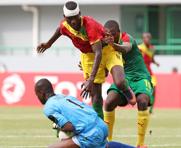 Moise Sakava Sangola of Cameroon challenged by Issiaga Camara and Ibrahima Sylla of Guinea during the 2017 Under 17 Africa Cup of Nations Finals football match between Guinea and Cameroon at the Port Gentil Stadium, Gabon on 17 May 2017 ©Muzi Ntombela/BackpagePix