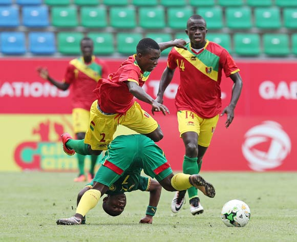 Rosin Christian Bella of Cameroon fouled by Samuel Conte and Salia Bangoura of Guinea during the 2017 Under 17 Africa Cup of Nations Finals football match between Guinea and Cameroon at the Port Gentil Stadium, Gabon on 17 May 2017 ©Muzi Ntombela/BackpagePix
