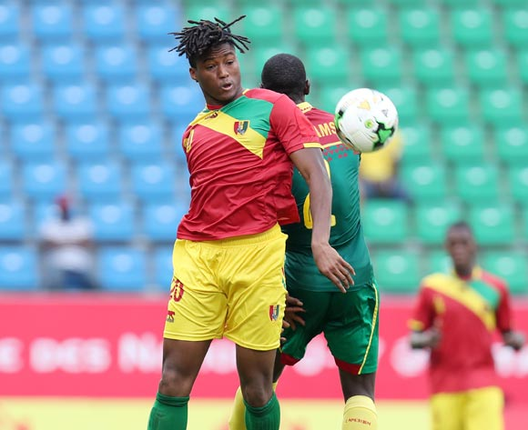 Gerard Sella Bangoura of Guinea challenged by Ahmad Toure Ngouyamsa Nounchili of Cameroon during the 2017 Under 17 Africa Cup of Nations Finals football match between Guinea and Cameroon at the Port Gentil Stadium, Gabon on 17 May 2017 ©Muzi Ntombela/BackpagePix