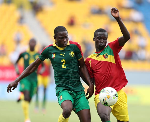 Ahmad Toure Ngouyamsa Nounchili of Cameroon challenged by Djibril Fandje Toure of Guinea during the 2017 Under 17 Africa Cup of Nations Finals football match between Guinea and Cameroon at the Port Gentil Stadium, Gabon on 17 May 2017 ©Muzi Ntombela/BackpagePix