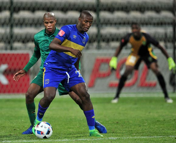 Judas Moseamedi of Cape Town City holds the ball up ahead of Romario Dlamini during the Absa Premiership 2016/17 game between Cape Town City and Golden Arrows at Athlone Stadium, Cape Town on 18 May 2017 © Ryan Wilkisky/BackpagePix