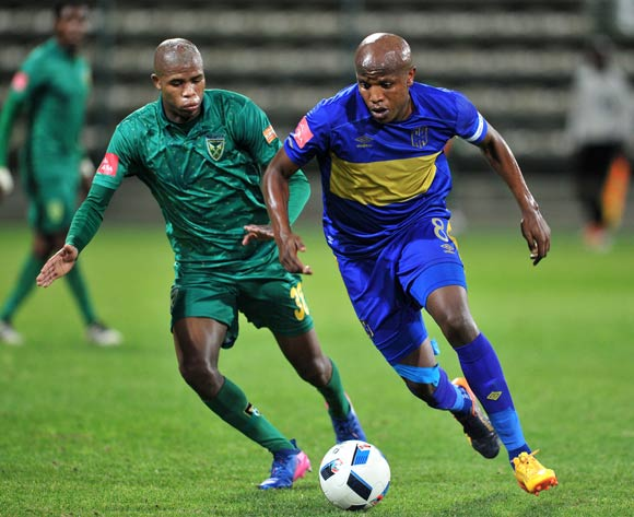 Lebogang Manyama of Cape Town City takes on Romario Dlamini of Golden Arrows during the Absa Premiership 2016/17 game between Cape Town City and Golden Arrows at Athlone Stadium, Cape Town on 18 May 2017 © Ryan Wilkisky/BackpagePix