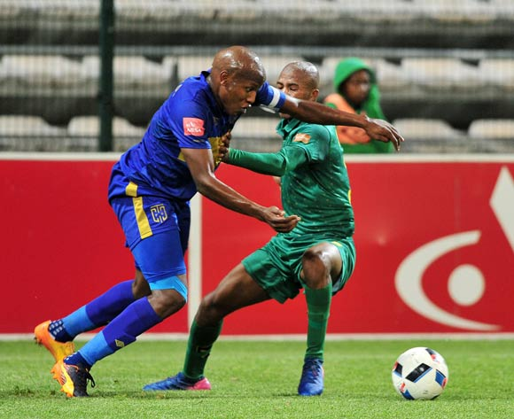 Lebogang Manyama of Cape Town City is brought down for a penalty by Romario Dlamini of Golden Arrows during the Absa Premiership 2016/17 game between Cape Town City and Golden Arrows at Athlone Stadium, Cape Town on 18 May 2017 © Ryan Wilkisky/BackpagePix