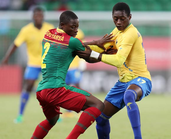 Alain Rodrick Miyogho of Gabon challenged by Ahmad Toure Ngouyamsa Nounchili of Cameroon during the 2017 Under 17 Africa Cup of Nations Finals football match between Gabon and Cameroon at the Port Gentil Stadium, Gabon on 20 May 2017 ©Muzi Ntombela/BackpagePix