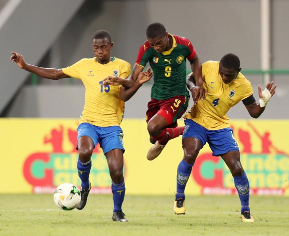 Stephane Thierry Zobo of Cameroon challenged by Aziz Giroly Bourobou Mombo and Christophe On a Nguema of Gabon during the 2017 Under 17 Africa Cup of Nations Finals football match between Gabon and Cameroon at the Port Gentil Stadium, Gabon on 20 May 2017 ©Muzi Ntombela/BackpagePix