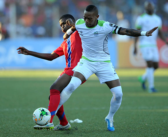 Vuyo Mere of Platinum Stars challenges  Njabulo Ndlovu of Mbabane Swallows during the  CAF Confederation Cup  match between Mbabane Swallows and Platinum Stars on 23 May 2017 at Somhlolo Stadium  © Sydney Mahlangu /BackpagePix
