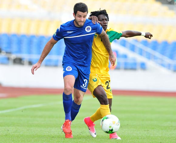 Keegan Ritchie of Supersport United challenged by Louis Ameka Actchanga of CF Mounana during the 2017 CAF Confederation Cup match between CF Mounana and Supersport United at the Libreville Stadium in Gabon on 23 May 2017 ©Samuel Shivambu/BackpagePix