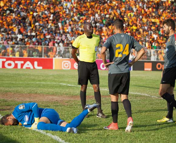 unisian football club Esperance Tunis players talk to a referee as their goalkeeper Moez Ben Cherifia (L) falls to the ground during their CAF Champions League match against Ethiopian football club Saint George in Addis Ababa, Ethiopia, 23 May 2017.