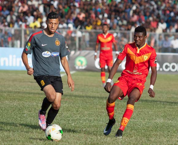 Anice Badri (L) of Tunisian football club Esperance Tunis and Séverin Waongo (R) of Ethiopian football club Saint George vie for the ball during the CAF Champions League match in Addis Ababa, Ethiopia, 23 May 2017.