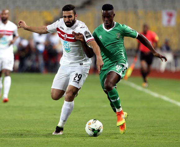 Al-Zamalek player Osama Ibrahim (L) in action against Caps United player Abbas Amidu  (R) during the African Champions League (CAF) Round of 16 match between Al-Zamalek and Caps United at at Borg Al Arab Stadium in Alexandria , Egypt, 12 May 2017