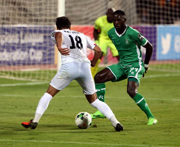 Al-Zamalek player Ahmed Refaat  (L) in action against Caps United player Justice Jangano  (R) during the African Champions League (CAF) Round of 16 match between Al-Zamalek and Caps United at at Borg Al Arab Stadium in Alexandria , Egypt, 12 May 2017
